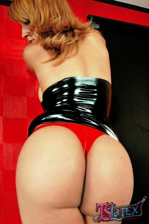 Big Butt Transsexual in a Shiny Latex Thong