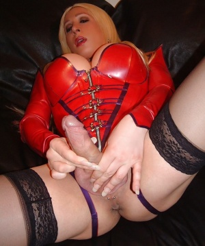 Big Cock TGirl in a Shiny Red Latex Corset