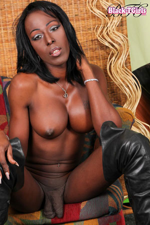 Huge Hung Black Tranny Cock in Knee Boots: www.tgirlcentral.com/black-tgirls