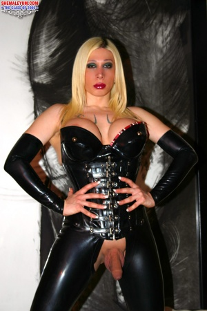 Blonde Shemale with Huge Tits in PVC Rubber and Latex