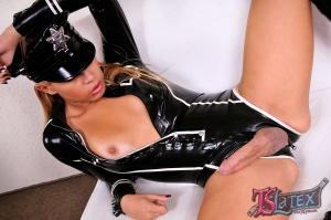 Latex Clad Tranny with a Huge Shecock