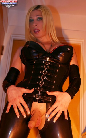Shaved Tranny Cock in a Tight Rubber and PVC Catsuit