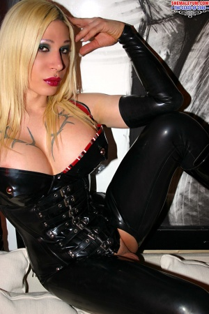 Shemale Eva Vortex in a Shiny Latex Corset