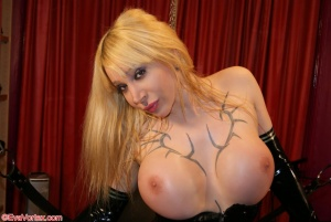 Tattooed Blonde Shemale with Huge Tits in Shiny Latex