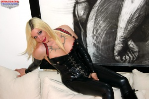 Tattooed Blonde Shemale in a Tight Latex Corset